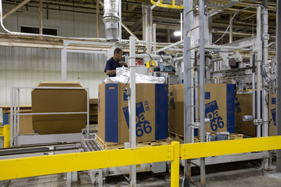 A worker packages polymer at Ascend's Pensacola plant. The plant is the largest integrated polyamide 66 production facility in the world and was recently recognized by GM with a Quality Supplier Award